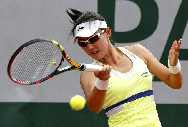 Saisai Zheng of China plays a shot to Lucie Hradecka of the Czech Republic during their women's singles match at the French Open tennis tournament at the Roland Garros stadium in Paris, France, May 25, 2015. (Photo by Gonzalo Fuentes/Reuters)