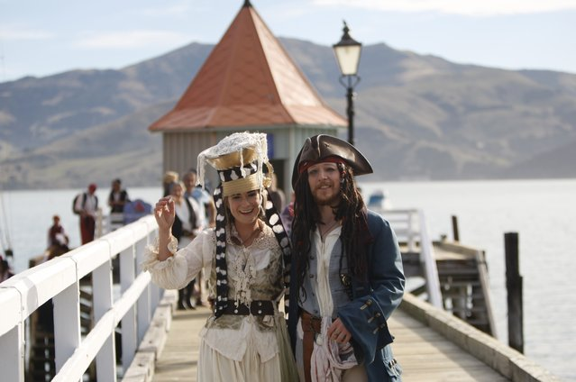 Bride Marianna Fenn and bridegroom Toby Ricketts stand on a jetty in Akaroa harbor, New Zealand, Saturday April 16, 2016. New Zealand hosted the world's first Pastafarian wedding, conducted by the Church of the Flying Spaghetti Monster. The group, which began in the U.S. as a protest against religion encroaching into public schools, has gained legitimacy in New Zealand, where authorities recently decided it can officiate weddings. (Photo by Nick Perry/AP Photo)