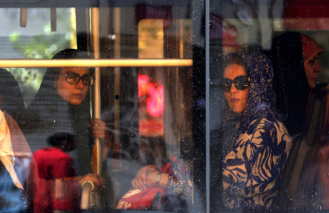 "Iranian women sit in a bus in the capital Tehran on June 25, 2019. Iran's President Hassan Rouhani said today that new US sanctions against senior Iranian officials including top diplomat Mohammad Javad Zarif showed Washington is ""lying"" about an offer to negotiate. (Photo by Atta Kenare/AFP Photo)"