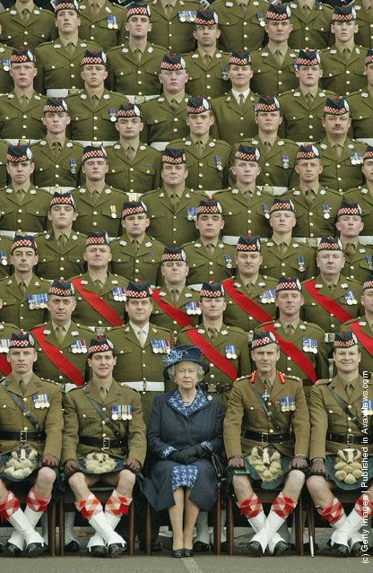 HRH Queen Elizabeth II Britain's poses at Howe Barracks in Canterbury, Kent with the 1st Battalion of The Argyll and Sutherland Highlanders with the Wilkinson Sword of Peace for establishing good relations with communities during their service in Iraq