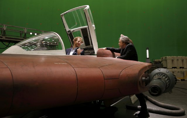 Britain's Prince Harry sits in an A-wing fighter as he talks with US actor Mark Hamill during a tour of the Star Wars sets at Pinewood studios in Iver Heath, west of London, Britain on April 19, 2016. (Photo by Adrian Dennis/Reuters)