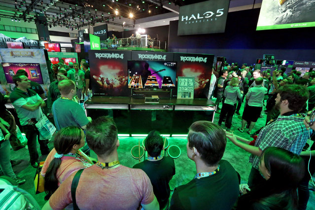 E3 2015 attendees get hands on with Rock Band 4 at the Xbox booth at E3 in Los Angeles on Tuesday, June 16, 2015. (Photo by Casey Rodgers/Invision for Microsoft/AP Images)