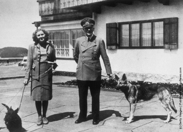 1940: Hitler with Eva Braun, his supposed wife, photographed with their dogs at Berchtesgaden