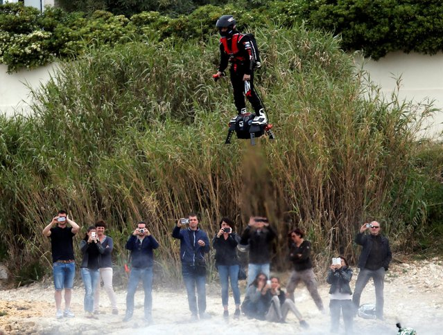 Pilot and jet-ski champion Franky Zapata breaks the Guiness World Records of the farthest flight by hoverboard with the IPU Flyboard Air after covering a distance of 2,252.4 meters (7,389.76 ft) with an average speed of 50-60km/h in Sausset les Pins near Marseille, France, April 30, 2016. (Photo by Jean-Paul Pelissier/Reuters)