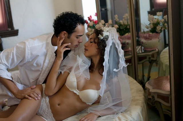 Young multi-ethnic couple in bed on their wedding night. (Photo by Juice Images Ltd/Getty Images)