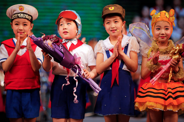 Children acknowledge the audience after performing on the stage of the Mangyongdae Children's Palace in central Pyongyang, North Korea May 5, 2016. (Photo by Damir Sagolj/Reuters)