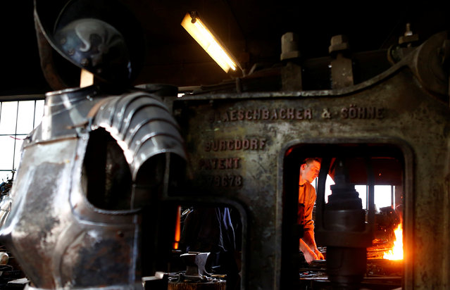 Blacksmith Johann Schmidberger works on an suit of armour for the Vatican's Swiss Guard at his workshop in Molln, Austria, March 29, 2017. (Photo by Leonhard Foeger/Reuters)