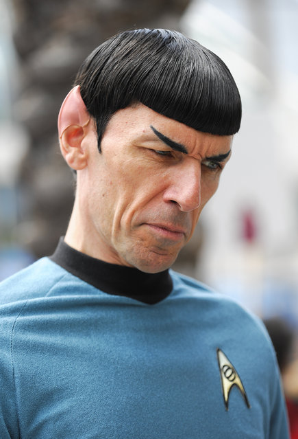 Spock Vegas dressed as Star Trek's Mr. Spock talks to fans on Fifth Avenue outside the convention center on the second day of the 2015 Comic-Con International held at the San Diego Convention Center Friday, July 10, 2015, in San Diego. (Photo by Denis Poroy/Invision/AP Photo)