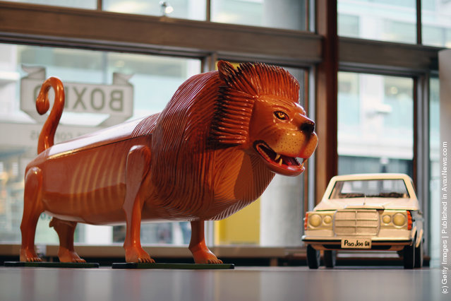 Coffins in the shape of a Lion and a car