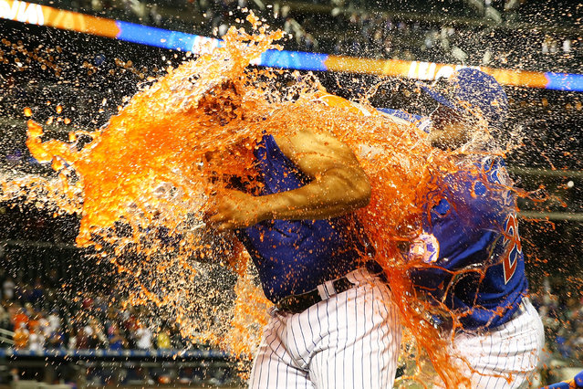 Dominic Smith #22 of the New York Mets has gatorade dumped on him after hitting a walk-off 3-run home run in the bottom of the eleventh inning against the Atlanta Braves at Citi Field on September 29, 2019 in New York City. (Photo by Mike Stobe/Getty Images)