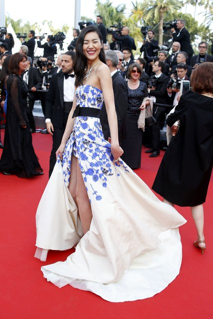 "Model Liu Wen poses on the red carpet as she arrives for the screening of the film ""La fille inconnue"" (The Unknown Girl) in competition at the 69th Cannes Film Festival in Cannes, France, May 18, 2016. (Photo by Yves Herman/Reuters)"