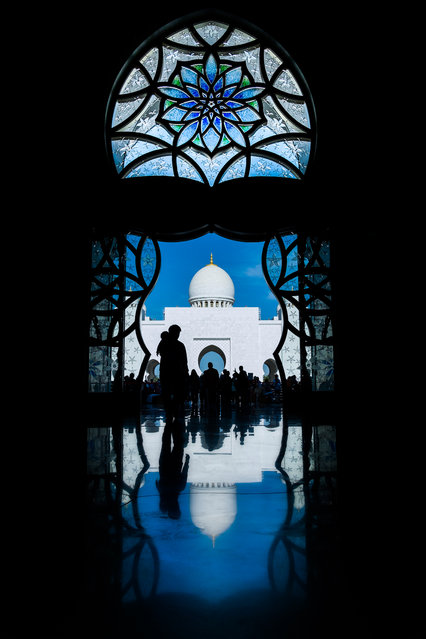 """Visiting"". Sheikh Zayed Grand mosque is one attractive place to be visited in Abu Dhabi. Photo location: Abu Dhabi. (Photo and caption by Amri Arfianto/National Geographic Photo Contest)"