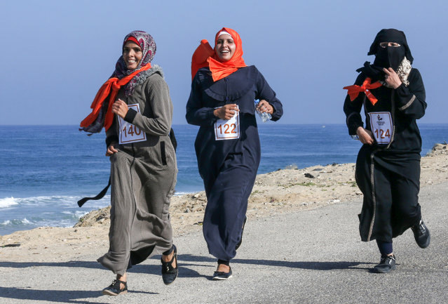 Palestinian women take part in a marathon calling for an end to violence against women, in Khan Yunis in the southern Gaza Strip on December 1, 2019. (Photo by Said Khatib/AFP Photo)