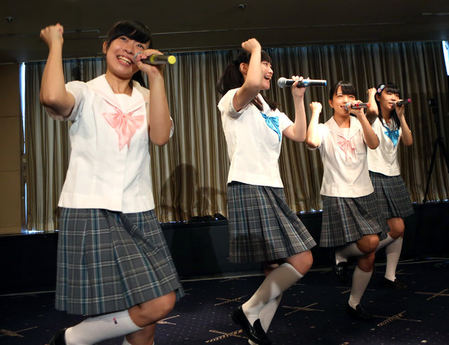 "Members of pop group Seifuku Kojo Iinkai, Rina Nishino, 15, Kana Kinashi, 17, Nao Saito, 15, and Yuria Saito, 18, perform in front of foreign media in Tokyo, Tuesday, July 28, 2015. The group ""Seifuku Kojo Iinkai"", which translates as ""Uniform Improvement Committee"", called on the international community of artists for support towards abandoning nuclear power. (Photo by Ken Aragaki/AP Photo)"