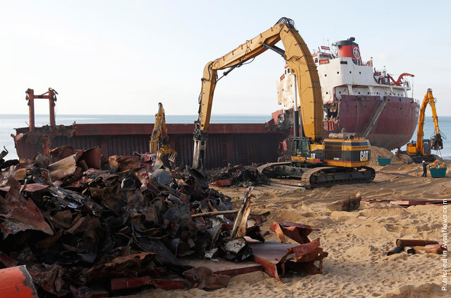 Some of the more than 2,000 tons of scrap lie on Kerminihy beach in front of the carcass of the TK Bremen, on January 13, 2012