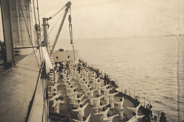 Sailors take part in morning exercises aboard a German Navy warship in this 1917 handout picture taken at an unknown location at sea. This picture is part of a previously unpublished set of World War One (WWI) images from a private collection. The pictures offer an unusual view of varied and contrasting aspects of the conflict, from high tech artillery to mobile pigeon lofts, and from officers partying in their headquarters to the grim reality of life and death in the trenches. The year 2014 marks the centenary of the start of the war. (Photo by Reuters/Archive of Modern Conflict London)