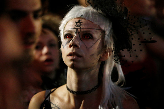 A fan is seen in the crowd during the performance of Yolandi Visser and Watkin Tudor Jones from South African rap duo Die Antwoord, in Rishon Lezion's Live Park Amphitheatre, near Tel Aviv, Israel,  June 8, 2016. (Photo by Amir Cohen/Reuters)