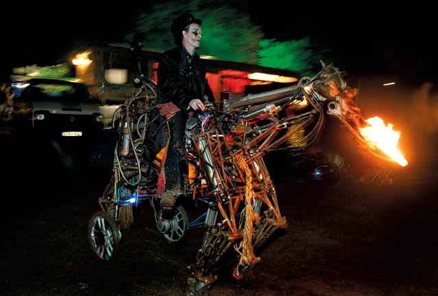 Paka the Uncredible on his steel steed, Lost Vagueness, Glastonbury, 2004. (Photo by Barry Lewis/Corbis/The Guardian)