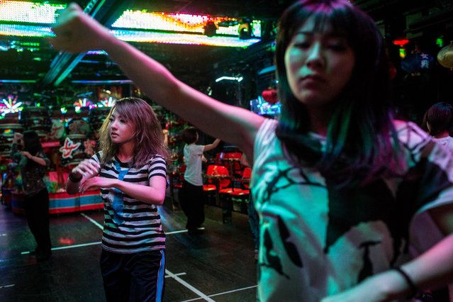 Dancers rehearse prior to the start of a show during a show at The Robot Restaurant on June 29, 2014 in Tokyo, Japan. The now famous Robot Restaurant opened two years ago in Kabukicho area of Shinjuku at an estimated cost of 10 million U.S. dollars. Performances are held three times a day and cater mostly to foreign tourists. (Photo by Chris McGrath/Getty Images)