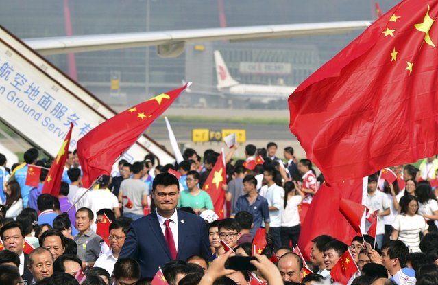 Former NBA player Yao Ming, also a member of the Beijing 2022 delegation, is welcomed as he returns with other delegates at the airport in Beijing, China, August 2, 2015. Beijing was chosen by the International Olympic Committee (IOC) to host the 2022 Winter Olympics on Friday, becoming the first city to be awarded both summer and winter Games. (Photo by Reuters/Stringer)