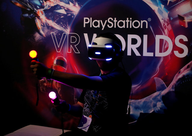 People try the new Sony VR headset during Sony Corporation's PlayStation 4 E3 2016 event in Los Angeles, California, U.S. June 13, 2016. (Photo by Mike Blake/Reuters)