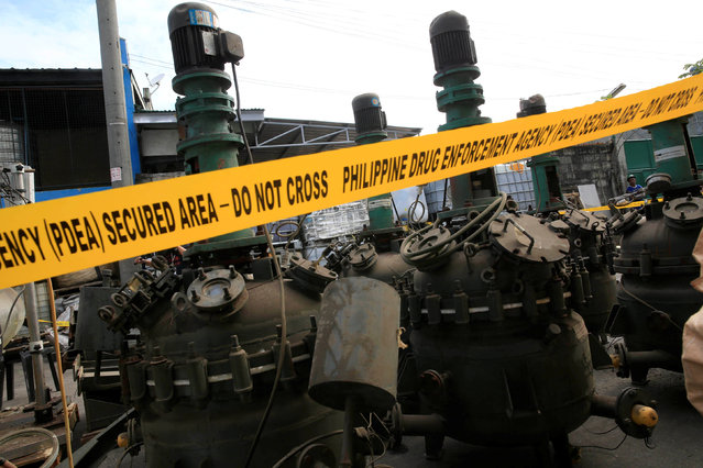 Laboratory equipment used in the productions of methamphetamine hydrochloride or Shabu is seen during a Philippine Drug Enforcement Agency destruction of chemicals and other evidence in Valenzuela city, north of Manila, Philippines May 24, 2016. (Photo by Romeo Ranoco/Reuters)
