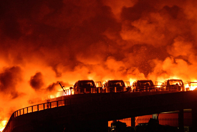 Fire and smoke are seen after explosions at a warehouse on late Wednesday in Binhai New Area on August 13, 2015 in Tianjin, China. At least 17 people dead, 32 are in critical condition and at least another 400 injured during the explosions of a warehouse on late Wednesday in Binhai New Area in Tianjin, according to police authority. (Photo by Tong Yu/CNSPHOTO/ChinaFotoPress via Getty Images)