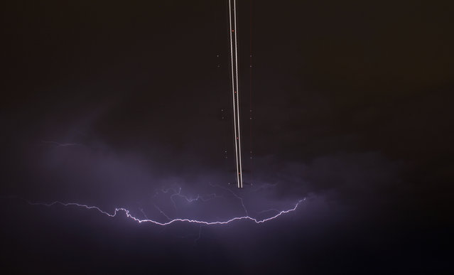 A jet aircraft takes off as lightning strikes across the sky during a monsoon storm at McCarran International Airport in Las Vegas, Nevada July 7, 2014. (Photo by Gene Blevins/Reuters)