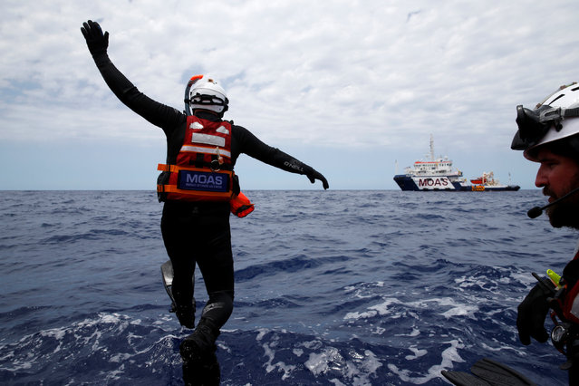 Rescue swimmers of the Migrant Offshore Aid Station (MOAS) take part in a training exercise off the MOAS ship Topaz Responder as the ship stands by for migrants in distress, in international waters off the coast of Libya, June 22, 2016. (Photo by Darrin Zammit Lupi/Reuters)