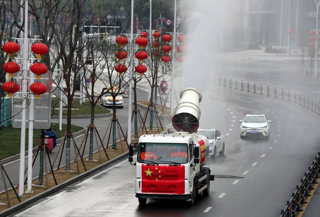 Workers operate a vehicle to carry out disinfection in Jianghan district, following an outbreak of the novel coronavirus in Wuhan, Hubei province, China February 10, 2020. (Photo by Reuters/China Daily)