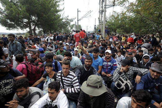 Migrants gather as they are stopped by Macedonian police at the Greek-Macedonian border, August 21, 2015. (Photo by Alexandros Avramidis/Reuters)