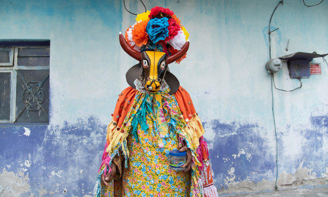 Inhabitants of the community of Coyolillo celebrate their Afro-descendant carnival in Veracruz, Mexico on February 25, 2020. This carnival has more than 100 years of history and is the heritage of the African workers who arrived in that area more than 300 years ago to work in the sugar cane fields. The event is known for the colourful robes, capes and animal masks – of bulls, deer, goats and cows – worn by participants. As such, the carnival is a unique expression of African-Mexican folk art. (Photo by Hector Adolfo Quintanar Perez/ZUMA Wire/Rex Features/Shutterstock)