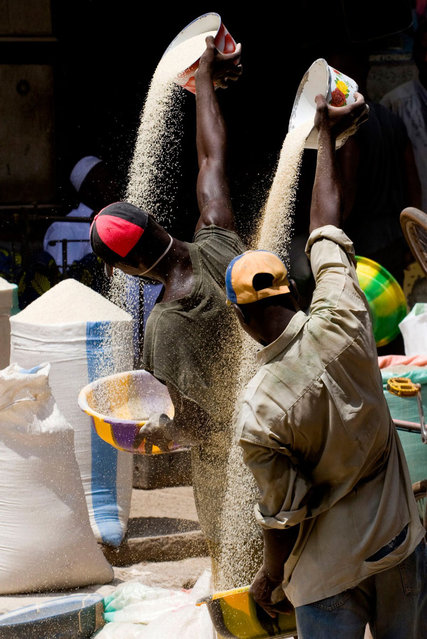 CGAP Photo Contest – Third Prize: Double Curves, Mali. These men work in the rice wholesaling market of Bamako. (Photo by Chi Keung Wong)