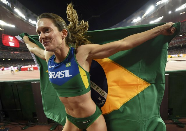 Fabiana Murer of Brazil celebrates with a national flag after winning silver at the women's pole vault final during the 15th IAAF World Championships at the National Stadium in Beijing, China, August 26, 2015. (Photo by Dylan Martinez/Reuters)