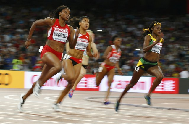 Elaine Thompson of Jamaica (R), Candyce McGrone of U.S. (L) compete in the women's 200 metres semi-final during the 15th IAAF World Championships at the National Stadium in Beijing, China August 27, 2015. (Photo by Damir Sagolj/Reuters)
