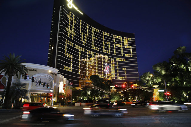 """Hotel room lights spell out """"Vegas Strong"""" at the Wynn hotel-casino along the Las Vegas Strip as casinos and other business are shuttered due to the coronavirus outbreak Wednesday, April 1, 2020, in Las Vegas. (Photo by John Locher/AP Photo)"""