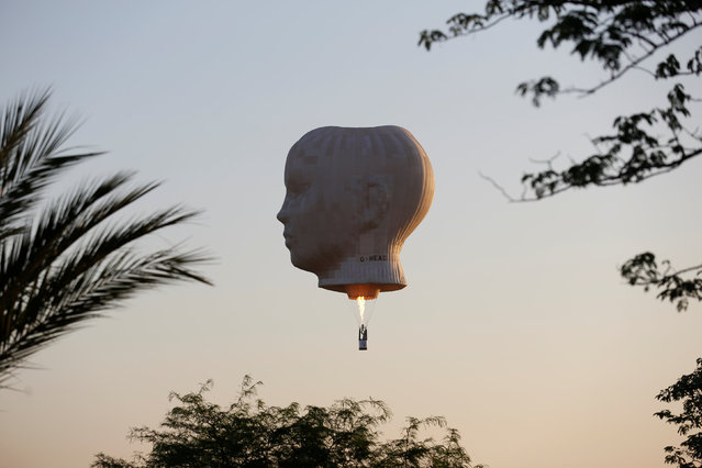 A hot air balloon floats during a two-day international hot air balloon festival in Eshkol Park near the southern city of Netivot, Israel July 22, 2016. (Photo by Amir Cohen/Reuters)