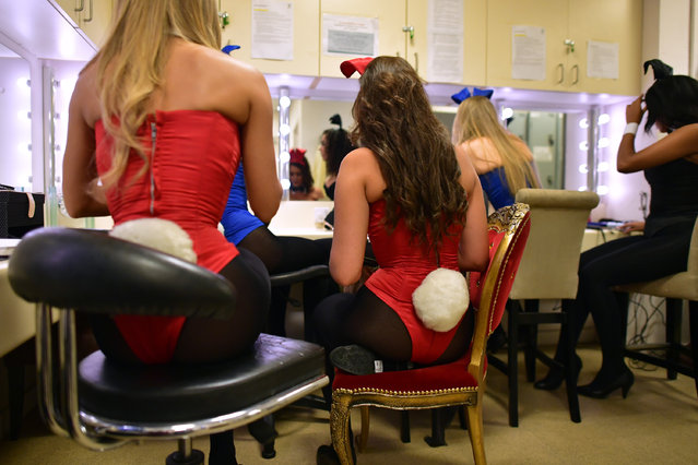Playboy Bunnies chat as they prepare themselves before starting work at the Playboy Club on July 26, 2016 in London, England. (Photo by Carl Court/Getty Images)