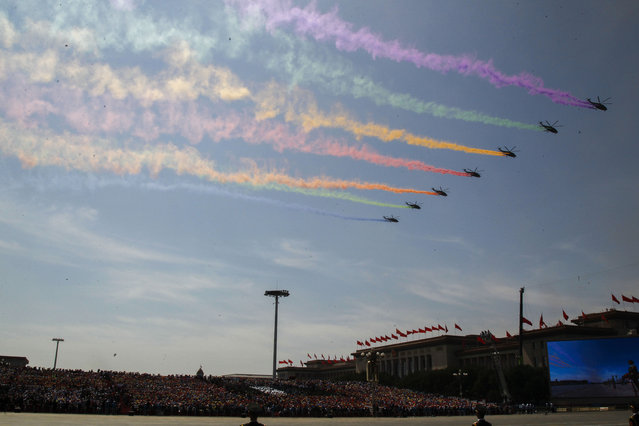Military aircraft fly in formation during a military parade to commemorate the 70th anniversary of the end of World War II, in Beijing Thursday, September 3, 2015. (Photo by Rolex Dela Pena/Pool Photo via AP Photo)