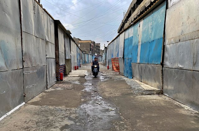 Closed shops are seen in old Baghdad, Iraq, Wednesday, March 18, 2020. Iraq announced a weeklong curfew to help fight the spread of the COVID-19 virus. (Photo by Khalid Mohammed/AP Photo)