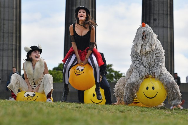 Comedians and cast members from the Pleasance's 2016 programme bounce on yellow spacehoppers in costume at Calton Hill on August 15, 2016 in Edinburgh, Scotland. The Pleasance and Waverley Care are marking a twenty five years in partnership, it's a unique relationship that helps raise awareness and challenges the stigma that continues to be attached to HIV and Hepatitis C and has raised more than £375,000 so far. (Photo by Jeff J. Mitchell/Getty Images)