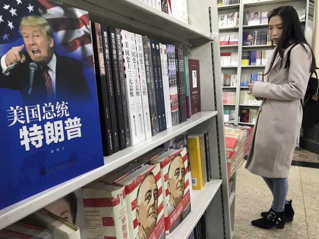 """A book with the title """"American President Trump"""" is placed on a shelf for a photo at a section of a book store on foreign leaders in Beijing, China, Tuesday, November 7, 2017. U.S. President Donald Trump's agenda in Beijing this week is expected to be led by the standoff over North Korea's nuclear weapons and demands that China do more to balance trade with America. (Photo by Ng Han Guan/AP Photo)"""