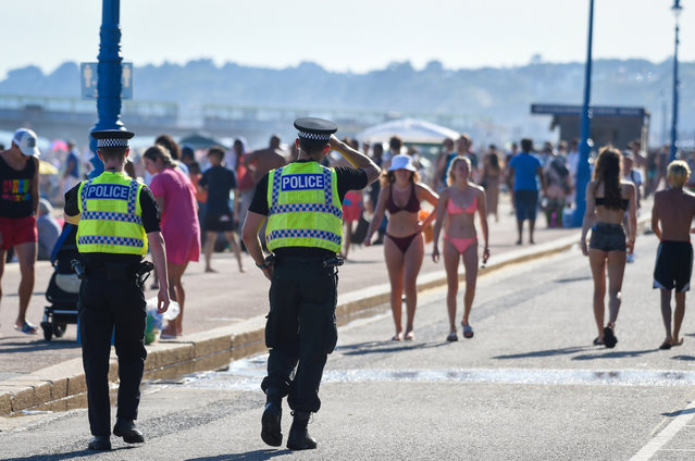 Police patrol the beach on June 25, 2020 in Bournemouth, United Kingdom. A major incident was declared by the local council as thousands flocked to Bournemouth and the Dorset coast. The UK is experiencing a summer heatwave, with temperatures in many parts of the country expected to rise above 30C and weather warnings in place for thunderstorms at the end of the week. (Photo by Finnbarr Webster/Getty Images)