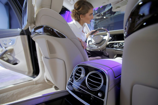 A model sits in a Maybach car on display at the 2016 Moscow International Auto Salon in Moscow, Russia, August 24, 2016. (Photo by Maxim Shemetov/Reuters)