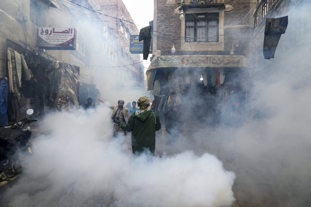 Health workers fumigate a market amid concerns of the spread of the coronavirus disease (COVID-19), in Sanaa, Yemen on April 30, 2020. (Photo by Khaled Abdullah/Reuters)