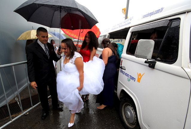 A couple gets out of the car to attend a mass wedding ceremony at Arena Corinthians soccer stadium in Sao Paulo, Brazil, September 26, 2015. (Photo by Paulo Whitaker/Reuters)