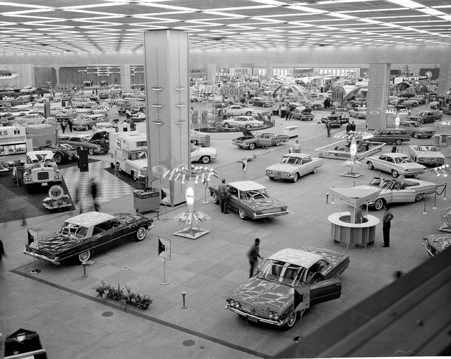 In this October 14, 1960 file photo, people visit the National Auto Show at Cobo Hall in Detroit. In 2013, more than 795,000 people, including 5,200 journalists from around the world attended the show. (Photo by AP Photo)