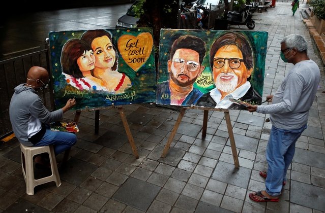 Artists create paintings depicting Bollywood actor Amitabh Bachchan, his son Abhishek Bachchan, his daughter-in-law Aishwarya Rai Bachchan and his granddaughter Aaradhya, after they tested positive for the coronavirus disease (COVID-19), in Mumbai, July 13, 2020. (Photo by Francis Mascarenhas/Reuters)