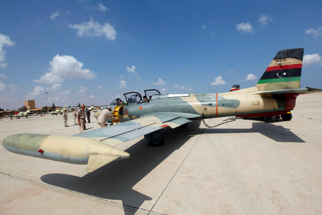 Members of Libyan forces allied with the UN-backed government prepare a renovated Libyan fighter jet at Misurata air base, Libya September 4, 2016. (Photo by Ismail Zitouny/Reuters)