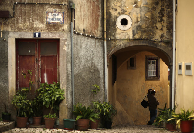 A man walks by a street in downtown Sintra October 7, 2014. (Photo by Rafael Marchante/Reuters)